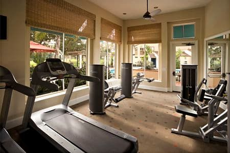 Interior view of fitness center at Rancho San Joaquin Apartment Homes in Irvine, CA.