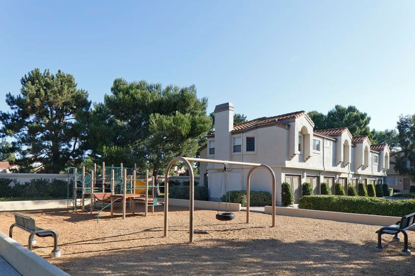 Exterior view of children's play area at San Carlo Villa in Irvine, CA.