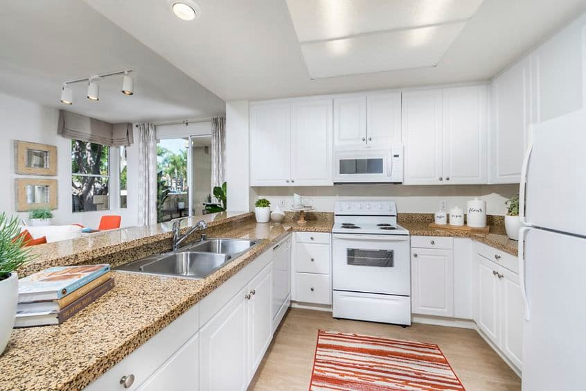 Interior view of kitchen at San Carlo Villa Apartment Homes in Irvine, CA.