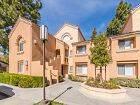 Exterior view of San Leon Villa Apartment Homes in Irvine, CA.