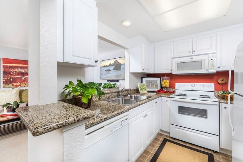 Interior view of kitchen at San Leon Villa Apartment Homes in Irvine, CA.