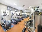 Interior view of fitness center at San Marco Apartment Homes in Irvine, CA.