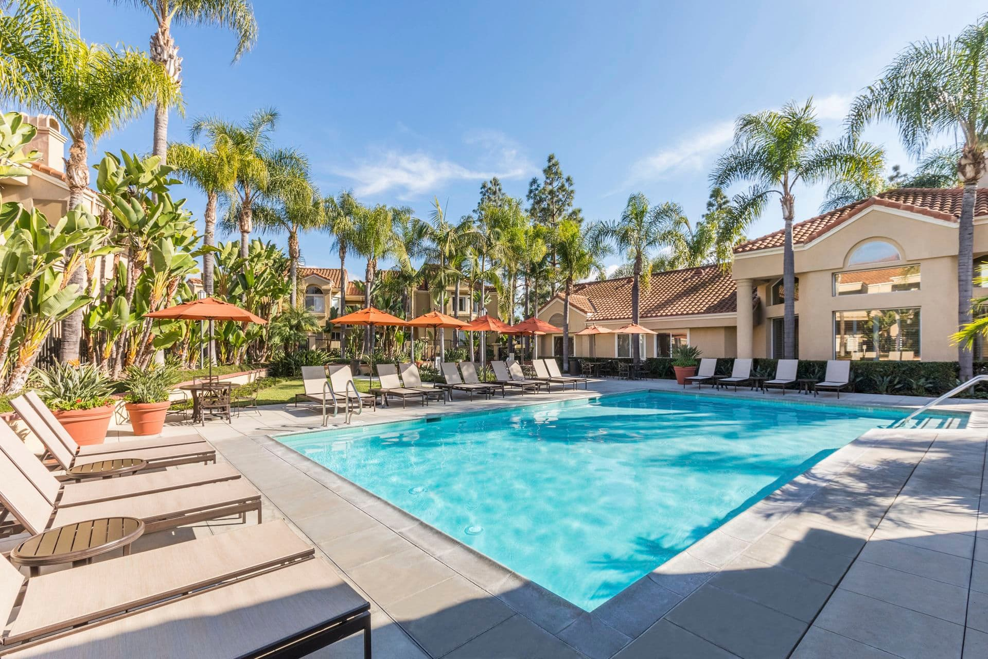 Exterior view of the pool at San Marco Villa Apartment Homes in Irvine, CA.