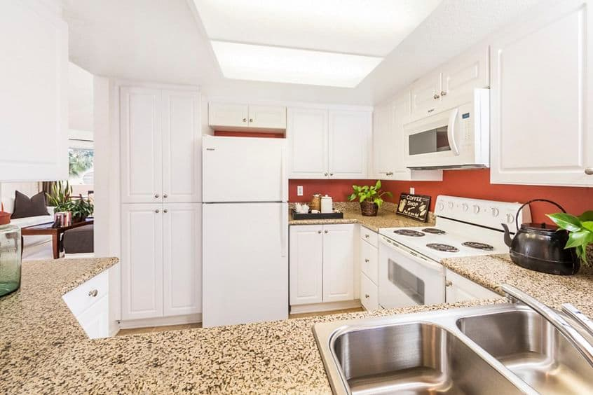 Interior view of kitchen at San Marco Apartment Homes in Irvine, CA.