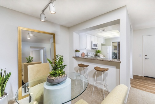 Interior view of living room and dining room at San Marino Villa Apartment Homes in Irvine, CA.