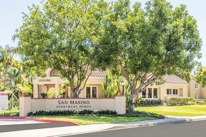 Exterior view of entry signage at San Marino Villa Apartment Communities in Irvine, CA.