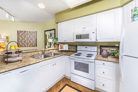Interior view of kitchen at San Mateo Apartment Homes in Irvine, CA.