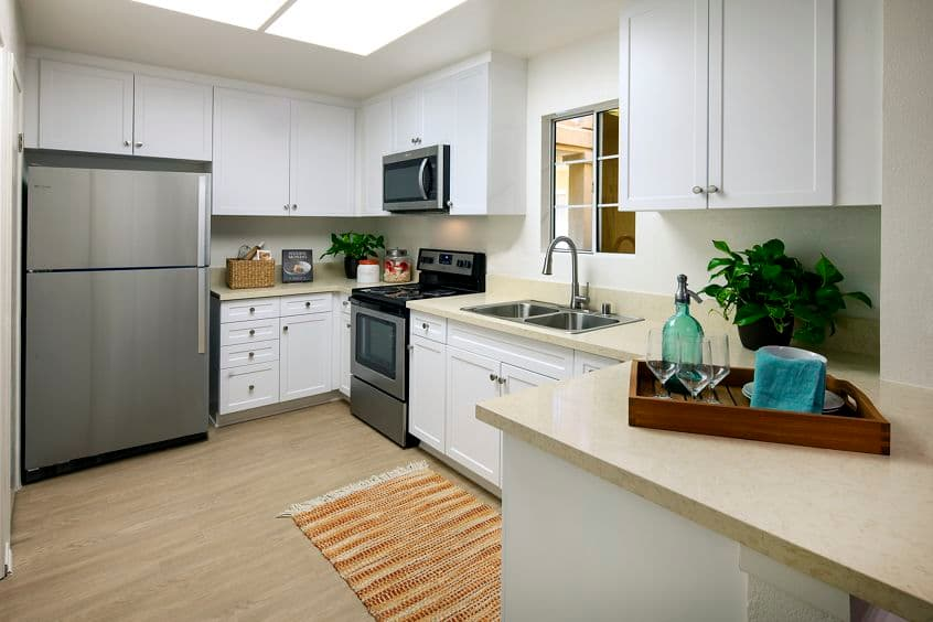 Interior view of kitchen of San Paulo Apartment Homes in Irvine, CA.