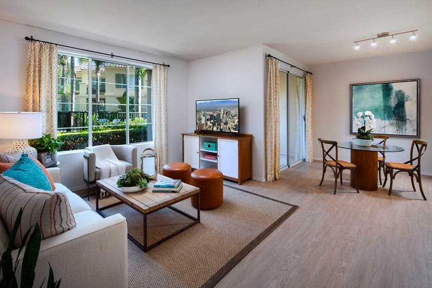 Interior view of living room and dining room of San Paulo Apartment Homes in Irvine, CA.