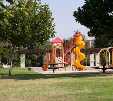 Exterior view of playground at San Remo Villa Apartment Homes in Irvine, CA.