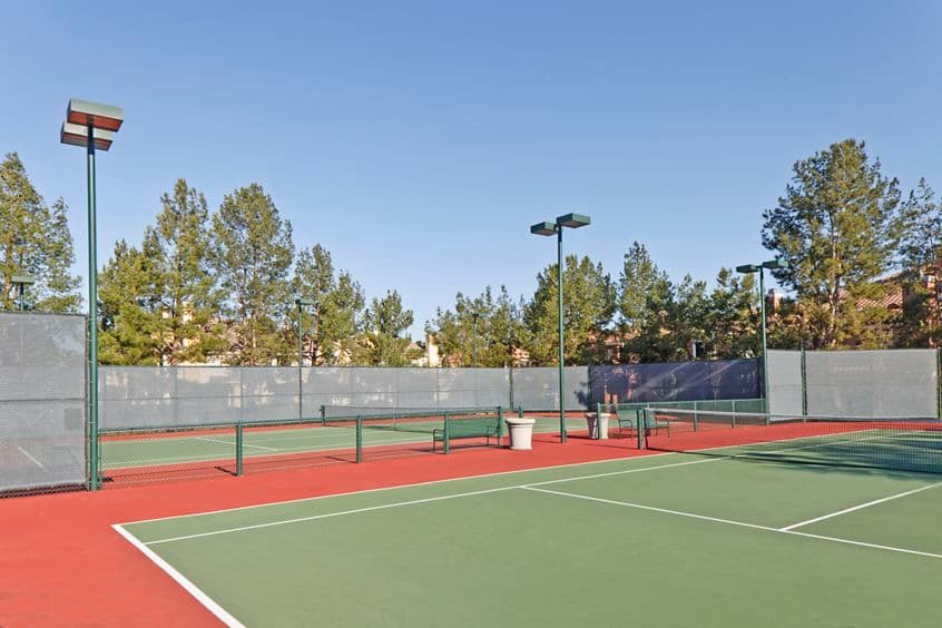 Exterior view of tennis courts at Santa Clara Apartment Homes in Irvine, CA.