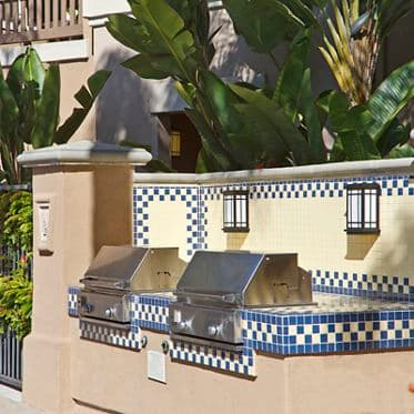 Exterior view of BBQ's at Santa Clara Apartment Homes in Irvine, CA.