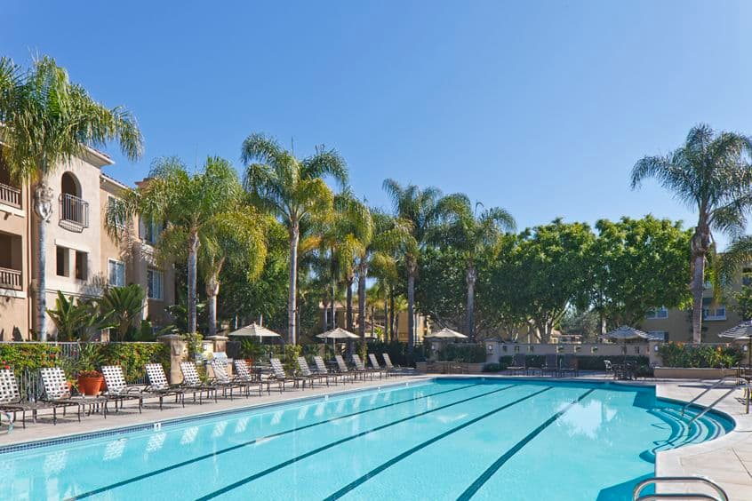 Daytime exterior view of pool at Santa Clara Apartment Homes in Irvine, CA.