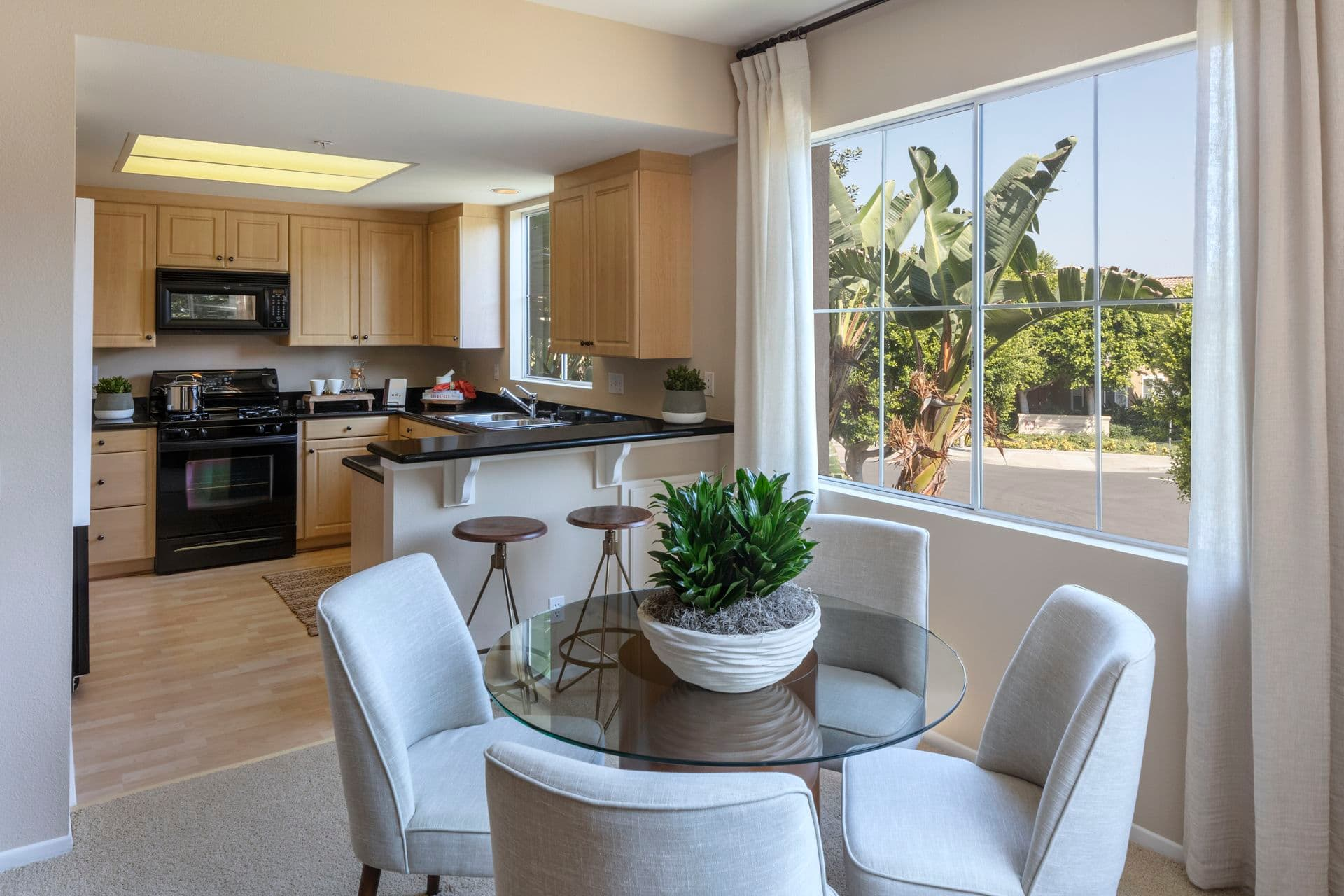 Interior view of kitchen and dining room at Santa Clara Apartment Homes in Irvine, CA.