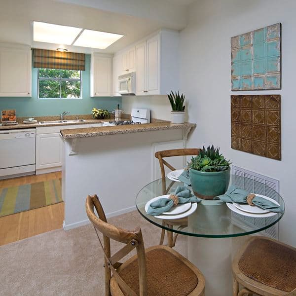 Interior view of kitchen and dining room at Santa Rosa Apartment Homes in Irvine, CA.