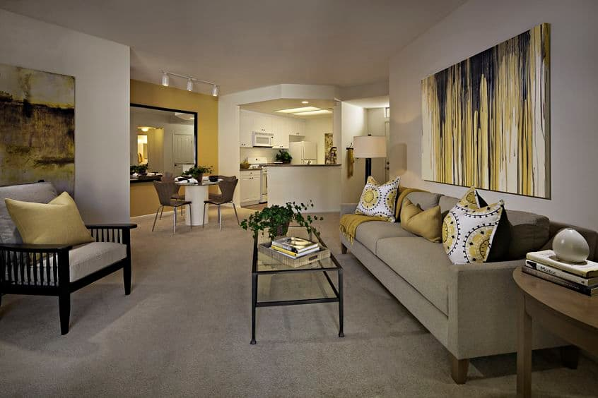 Interior view of living room, dining room, and kitchen at Santa Rosa Apartment Homes in Irvine, CA.