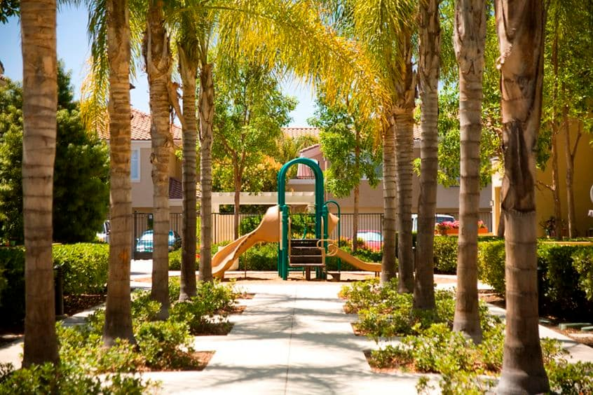 Exterior view of children's playground at Santa Rosa Apartment Homes in Irvine, CA.