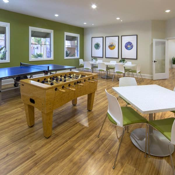 Interior view of clubhouse game room at Santa Rosa Apartment Homes in Irvine, CA.