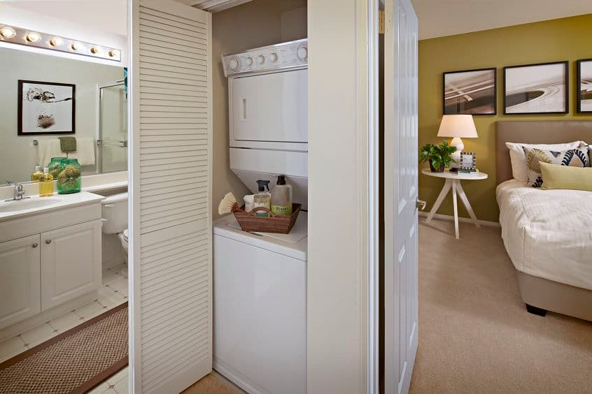 Interior view of bathroom and laundry room at Serrano Apartment Homes in Irvine, CA.