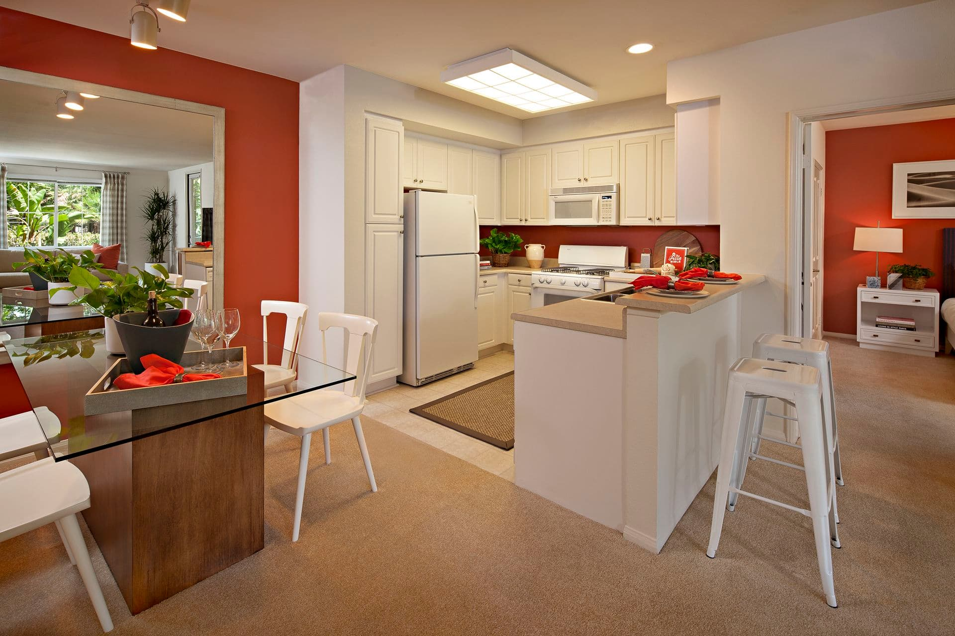 Interior view of kitchen and dining room at Serrano Apartment Homes in Irvine, CA.