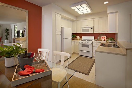 Exterior view of kitchen and dining room at Serrano Apartment Homes in Irvine, CA.