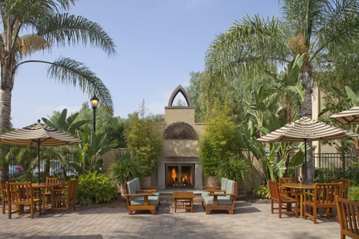 Exterior view of fireplace at Serrano Apartment Homes in Irvine, CA.