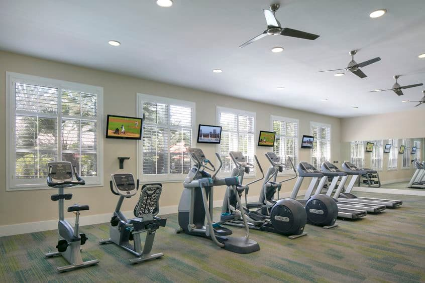 Interior view of fitness center at Serrano Apartment Homes in Irvine, CA.