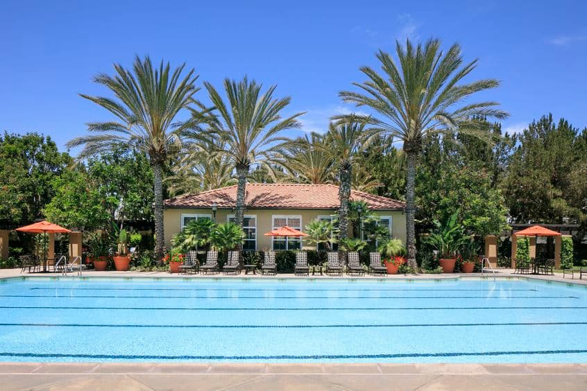 Exterior view of pool at Serrano Apartment Homes in Irvine, CA.