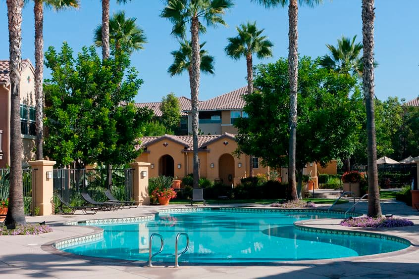 Exterior view of pool at Solana Apartment Homes in Irvine, CA.