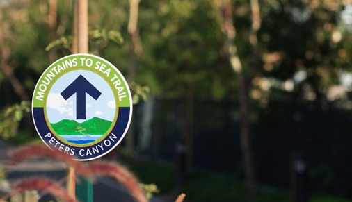 Exterior view of Peters Canyon Trail sign at Somerset Apartment Homes in Irvine, CA.