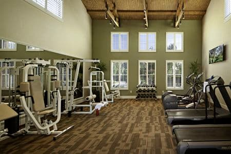 Interior view of fitness center at Sonoma Apartment Homes at Oak Creek in Irvine, CA.