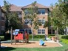 Exterior view of playground at Sonoma Apartment Homes at Oak Creek in Irvine, CA.