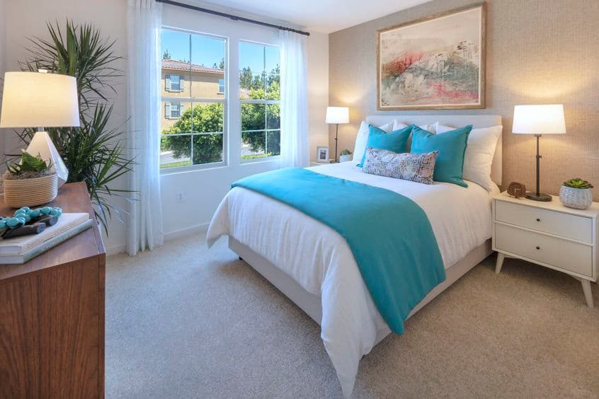 Interior view of bedroom at Palmeras Apartment Homes in Irvine, CA.