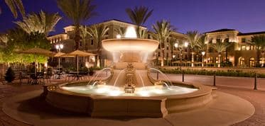 Exterior view of the courtyard fountain at The Park at Irvine Spectrum Apartment Homes in Irvine, CA.