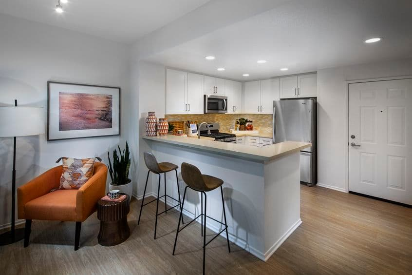 Interior view of kitchen at Cambria at The Village at Irvine Spectrum Apartment Homes in Irvine, CA.