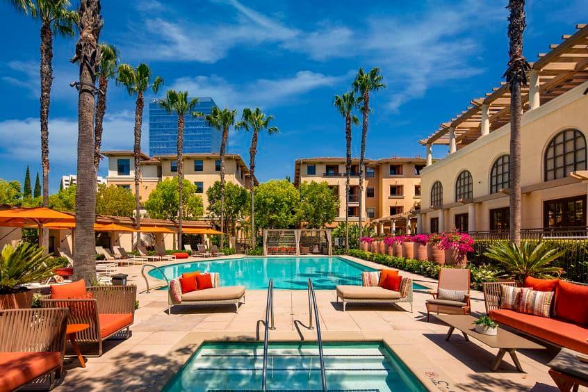 Exterior pool view at Cambria at The Village at Irvine Spectrum Apartment Homes in Irvine, CA.