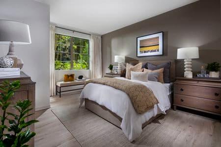 Interior view of bedroom at Delrey at The Village at Irvine Spectrum Apartment Homes in Irvine, CA.