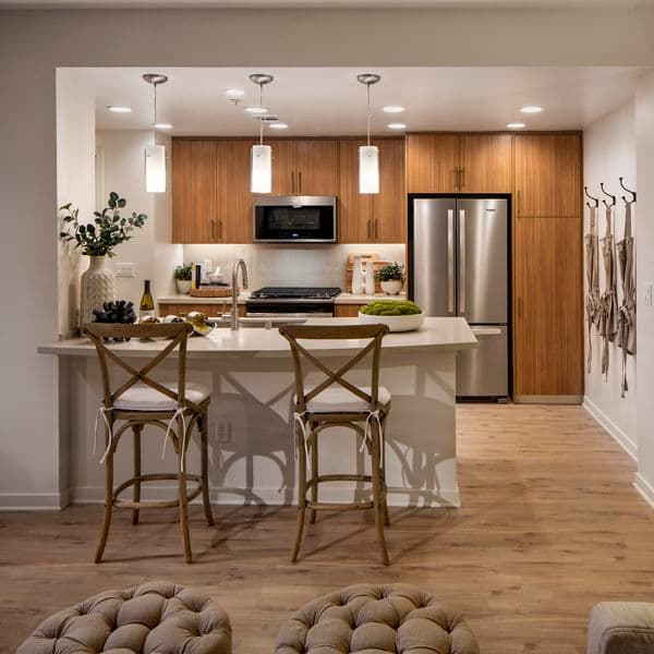 Interior view of kitchen at Delrey at The Village at Irvine Spectrum Apartment Homes in Irvine, CA.