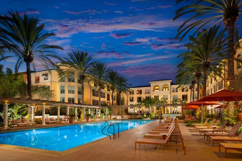 Exterior view of pool at Delrey at The Village at Irvine Spectrum Apartment Homes in Irvine, CA.at Delrey at The Village at Irvine Spectrum Apartment Homes in Irvine, CA.