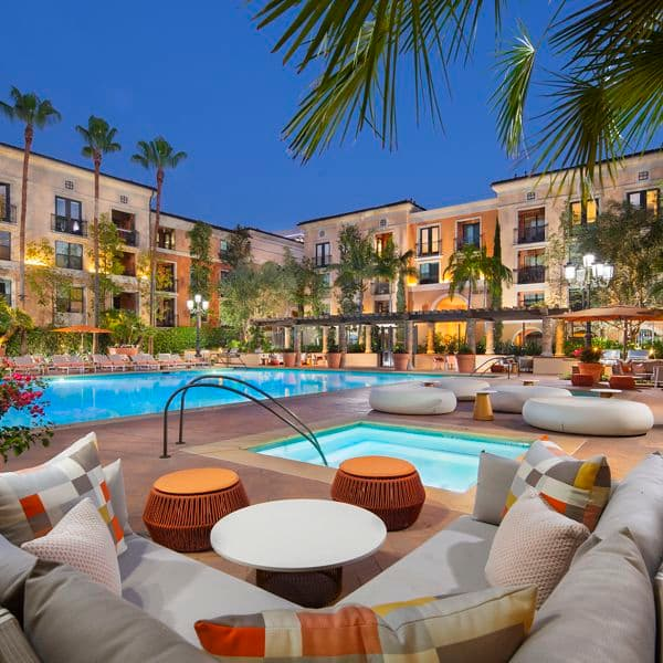 Exterior view of pool at Serena at The Village at Irvine Spectrum Apartment Homes in Irvine, CA.