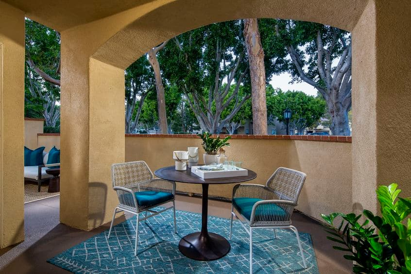 Exterior view of apartment patio at Turtle Rock Canyon Apartment Homes in Irvine, CA.