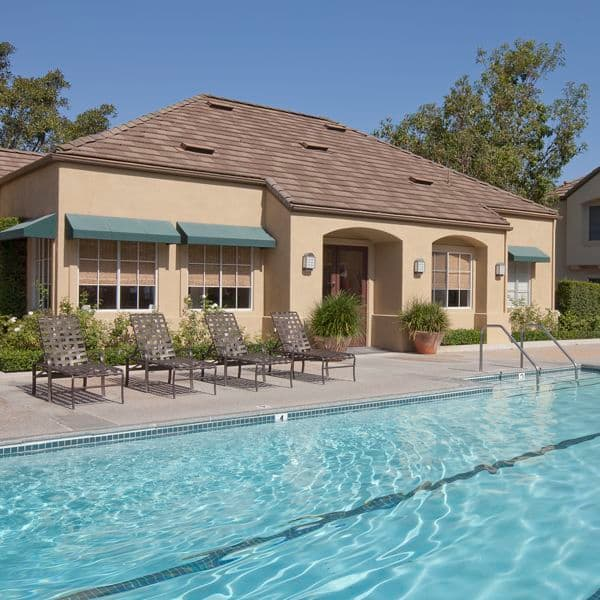 Exterior view of pool at Turtle Rock Canyon Apartment Homes in Irvine, CA.