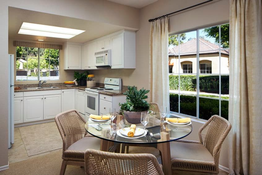 Interior view of kitchen and dining room at Turtle Rock Canyon Apartment Homes in Irvine, CA.