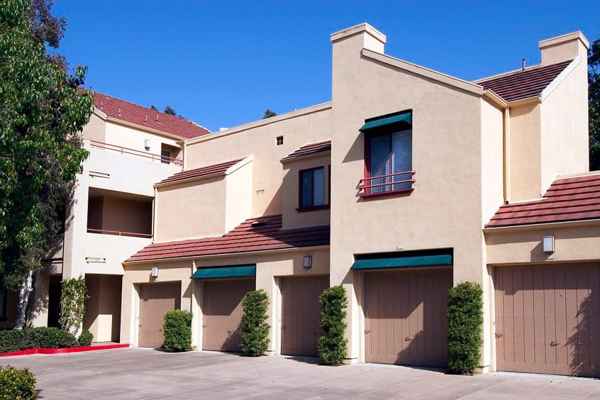 Exterior view of garage spaces at Ambrose Apartment Homes at University Town Center in Irvine, CA.