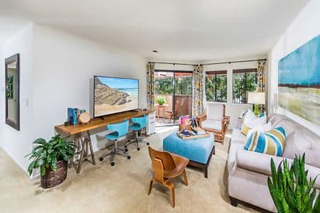 Interior view of living room at Berkeley Court Apartment Homes at University Town Center in Irvine, CA.