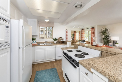 Interior view of kitchen at Dartmouth Court Apartment Homes at Town Center in Irvine, CA.