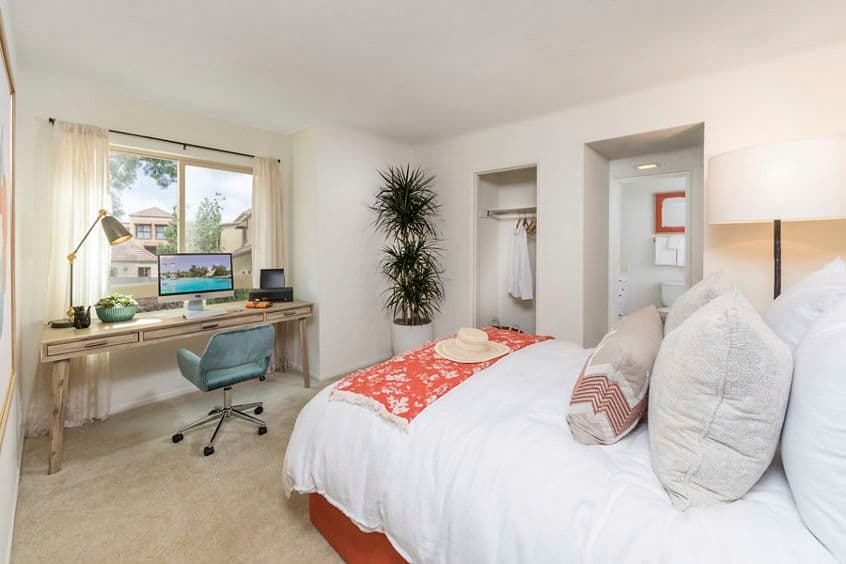 Interior view of bedroom at Dartmouth Court Apartment Homes at Town Center in Irvine, CA.