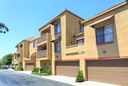 Exterior view of garage spaces at Dartmouth Court Apartment Homes at University Town Center in Irvine, CA.