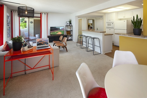 Interior view of living area at Dartmouth Court Apartment Homes at University Town Center in Irvine, CA.