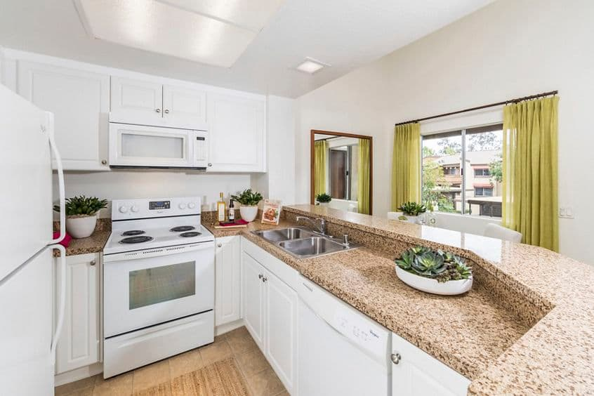 Interior view of kitchen at Harvard Court Apartment Homes at Town Center in Irvine, CA.